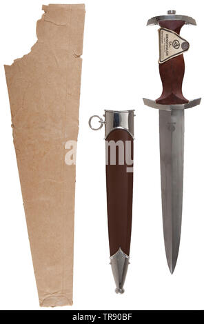 An SA service dagger M 33 with RZM label Well preserved blade, etched motto 'Alles für Deutschland' and manufacturer's code 'M 7/104' (Ludwig Zeitler). Nickel-plated crossguards, brown wooden grip inset with SA emblem and nickel silver eagle, triangular paper label bearing the printed inscription 'SA-Dienstdolch'. Brown steel scabbard with nickel-plated fittings. Brown paper issue bag printed 'SA-Dolch'. Length 35 cm. Difficult to find in this condition. USA-lot, see page 4. historic, historical, 20th century, 1930s, 1940s, storm battalion, stormtroopers, armed and uniforme, Editorial-Use-Only - Stock Photo