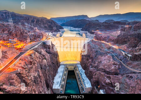 Hooover Dam on the Colorado River straddling Nevada and Arizona at dawn. - Stock Photo