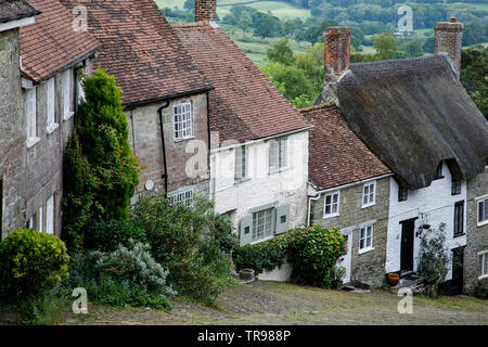 SHAFTESBURY, UK - MAY 19th, 2019: Gold Hill is a steep cobbled street in the town of Shaftesbury in the English county of Dorset. It is famous for its - Stock Photo