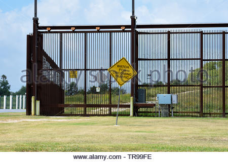 Brownsville Border Fence. Border Fence. United States - Mexico Border Fence in Brownsville, Texas. The Border Wall. Fence on Mexican Border in Texas. - Stock Photo