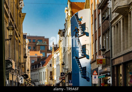 Tin Tin running down a  staircase painted on the side of a building  along Rue de l'Etuve,Brussels,Belgium - Stock Photo