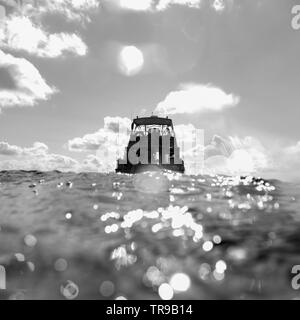 Diving boat in the sea, East Wall, Dive Site, Belize - Stock Photo
