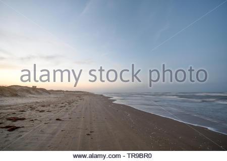 Sunset on the beach. Sunset on Boca Chica Beach on the Texas Gulf Coast. Texas Gulf Coast Sunset. Texas Sunset. Desolate Beach Cameron County Texas. - Stock Photo