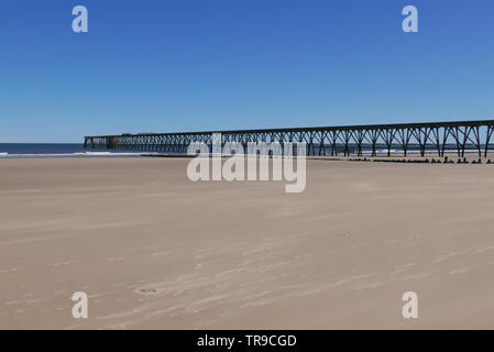 Steetley Pier near Hartlepool, Couty Durham, England UK - taken from beach. Pier was used to collect seawater for local Magnesia industry - Stock Photo