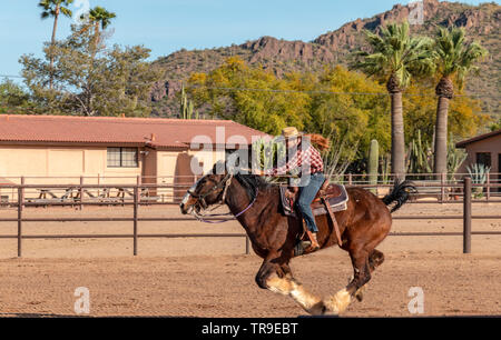 Weekly rodeo at White Stallion Ranch, a dude ranch outside Tucson, AZ. Woman rider at a gallop. - Stock Photo