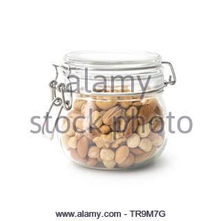 Mixed nuts in the glass jar , clipping path - Stock Photo