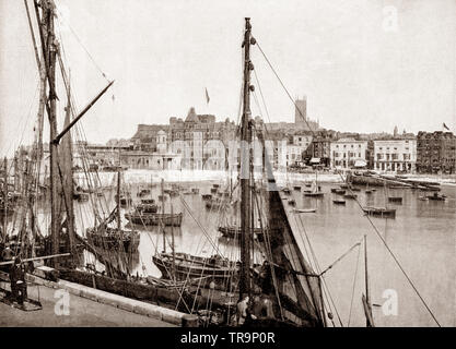 A 19th Century view of fishing boats and yachts in Margate harbour. Margate a seaside town in Thanet, Kent, South East England has been a leading seaside resort and a traditional holiday destination for Londoners drawn to its sandy beaches, for at least 250 years. - Stock Photo