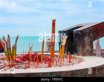 China, Sanya NOVEMBER 13, 2017: Burning big red candles Chinese,Red candles with flame in Chinese temple for concept of festive religious pray, symbol - Stock Photo