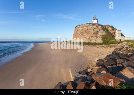 Nobbys Lighthouse is one of the most famous landmarks in Newcastle - Australia's second oldest city. - Stock Photo