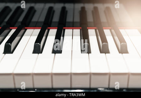 classic Piano keyboard closeup with warm light and selective focus, music instruments concept - Stock Photo