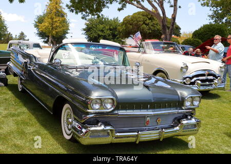 An Oldsmobile Eighty-Eight convertible amongst vintage vehicles and Hot Rods at a memorial day event at Boulder City, Nevada, USA - Stock Photo