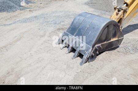 Hydraulic excavator digger bucket breaking new ground on Ko Lipe island, Thailand - Stock Photo