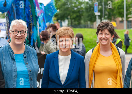 Glasgow, Scotland, UK. 1st June, 2019: Mhairi Hunter, SNP councillor for Glasgow Southside Central (left), Nicola Sturgeon MSP, the First Minister Of Scotland (middle) and Alison Thewliss MP (right) attend the annual Gorbals Fair which starts with a procession through the streets of The Gorbals. Credit: Skully/Alamy Live News - Stock Photo