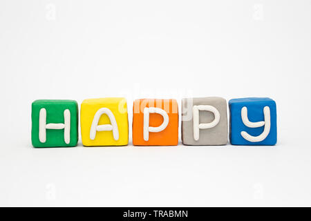 The word 'Happy' on the clay colorful blocks - Stock Photo
