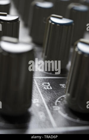 Close up of a mixing desk in an audio recording studio - Stock Photo