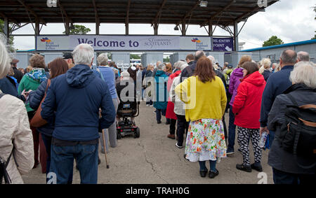 1st June, 2019, Ingliston, Edinburgh, Scotland. Gardening Scotland 2019, Best Show Garden, Gold Medal awarded by Royal Caledonian Horticultural Society for 'The Coffee Garden' designed by Kirsty Wilson, Herbaceous Supervisor  of Royal Botanic Garden Edinburgh with its suspended chair centre piece. Crowds flocked to the annual garden show on a rather cloudy Saturday to see the various exhibits, show gardens and to purchase plants direct from growers from all over Scotland and UK. - Stock Photo