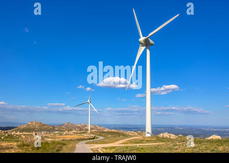 View of a mountains landscape with road and wind turbines on top, in Portugal - Stock Photo