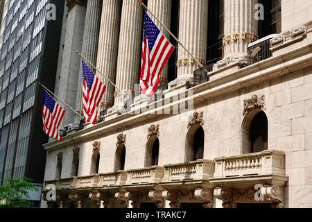 Three American flags fly in front of the New York Stock Exchange, Lower Manhattan, New York, NY, USA