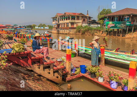 Flower sellers at the temple entrance, Inle Lake Myanmar - Stock Photo