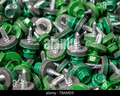 Background from roofing screws of green color - Stock Photo