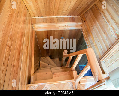 Wooden spiral staircase from the second floor to the first - Stock Photo
