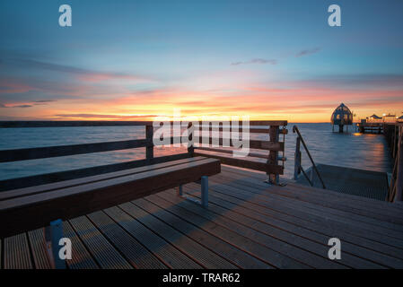 On the seabridge in grömitz during blue hour and calm sea - Stock Photo