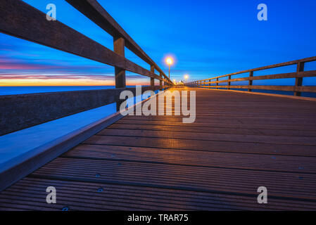 On the seabridge in grömitz during an evening in last summer - Stock Photo