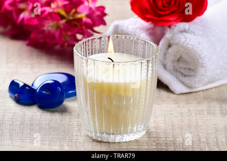 candle with flower, stones and towel, spa compostion, spa concept. - Stock Photo