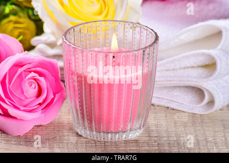 Spa composition with candles, flowers on ,wooden background. - Stock Photo