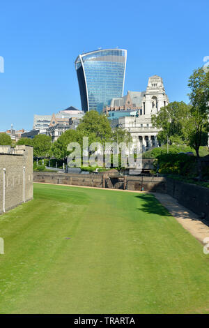 View over Tower of London moat towards Tower Hill and the City, London, United Kingdom - Stock Photo