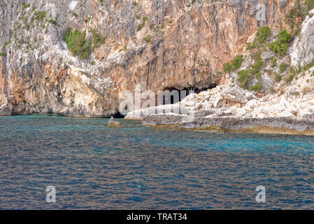 Cala dei Gabbiani, a narrow sandy beach below high limestone cliffs, Gulf of Orosei, Gennargentu National Park, Baunei, Sardinia, Italy, 20th May 2019 - Stock Photo