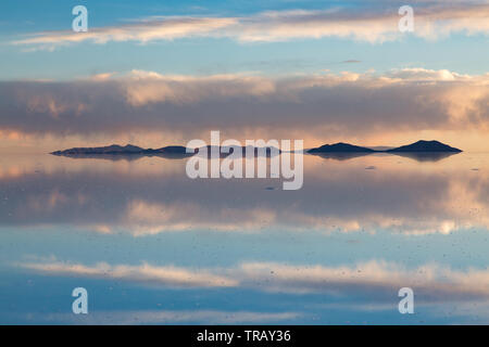 Clouds Reflected On The Uyuni Salt Flats In Bolivia Stock Photo Alamy