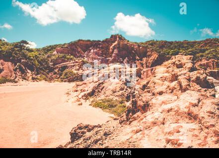 Red cliffs at Coqueirinho's beach in Conde, Paraiba, Brazil - Stock Photo