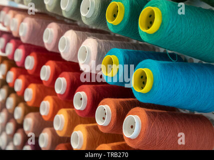 Coloured yarn reels - Stock Photo