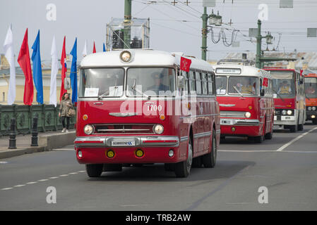 RUSSIA, SAINT-PETERSBURG - MAY 25, 2019: Bus Ikarus 55.14 Lux at the head of a column of intercity buses. Fragment of retro transport parade on City D - Stock Photo