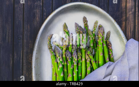 Asparagus on a metal plate - Stock Photo