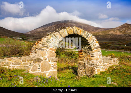 Northern Ireland, Co Down, Newcastle, Bloody Bridge, remains of St Mary's ancient church below Slieve Donard, restored archway - Stock Photo