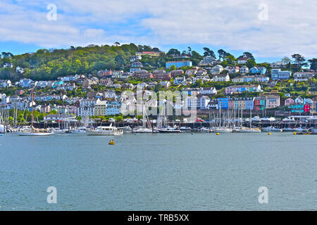 The village of Kingswear where the houses cling to the hillside, & look over the river Dart towards Dartmouth.A popular yachting marina & ferry port - Stock Photo