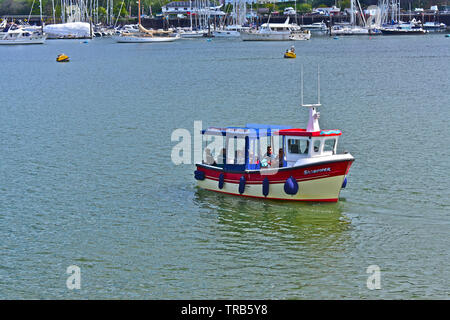 The small ferry boat 'Sandpiper' carries passengers on the pretty river trip between Dittisham and Dartmouth.Seen here approaching Dartmouth. - Stock Photo