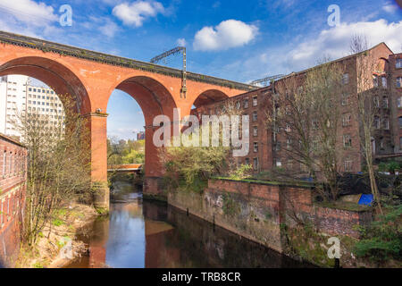View of Stockport railway viaduct over the River Mersey, with the new road bridge, built 2019. visible through the centre arch. Stockport, Cheshire, U - Stock Photo