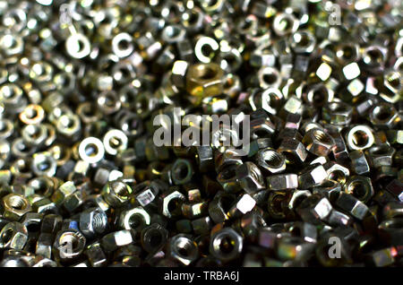 Background of screw bolts, Internal screw, nuts, many screws.  Factory equipment and Industrial concept. - Stock Photo