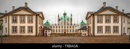 Fredensborg Palace is a palace located on the eastern shore of Lake Esrum in Fredensborg on the island of Zealand in Denmark. - Stock Photo