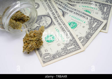 Money and marijuana concept for stock prices bullish and bearish - Stock Photo