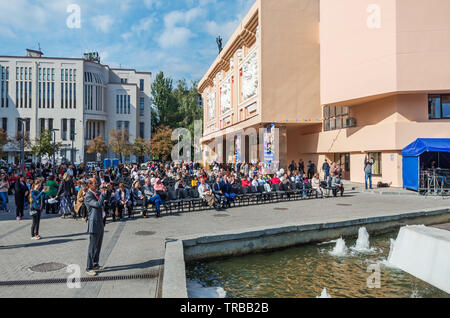 Dnipro, Ukraine - September 29, 2018: Spectators on the theater square on celebration of 100th anniversary of Dnipro Academic Ukrainian Music and Dram - Stock Photo