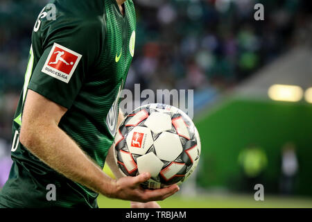 Wolfsburg, Germany, August 11, 2018: soccer player, Maximilian Arnold, take the official bundesliga ball in the 2018-2019 season. - Stock Photo
