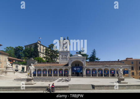 Udine, Italy  - Piazza della Libertà (Freedom Square) with the hanging flags of the nations of the 2019 U21 European football championship - Stock Photo