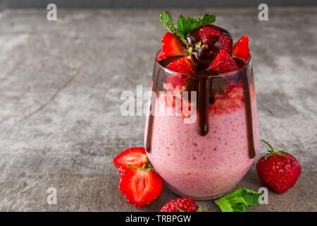 healthy delicious breakfast. strawberry chia seed pudding with chocolate, fresh berries and mint. close up - Stock Photo