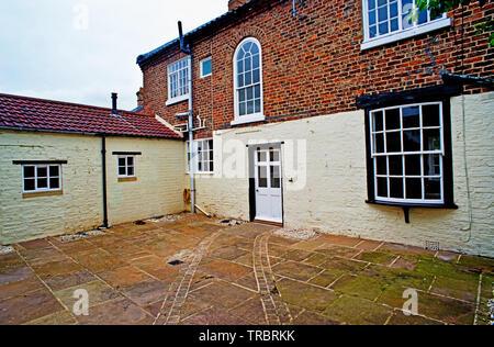 Courtyyard, Raby House, Chapel Row, Sadberge, Borough of Darlington, England - Stock Photo