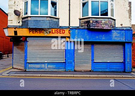 Run down closed Shop, Redcar, Cleveland, England - Stock Photo