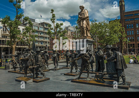 Rembrandt Square with sculptures from the Night Watch picture in Amsterdam. City with huge cultural activity, canals and bridges in Netherlands. - Stock Photo